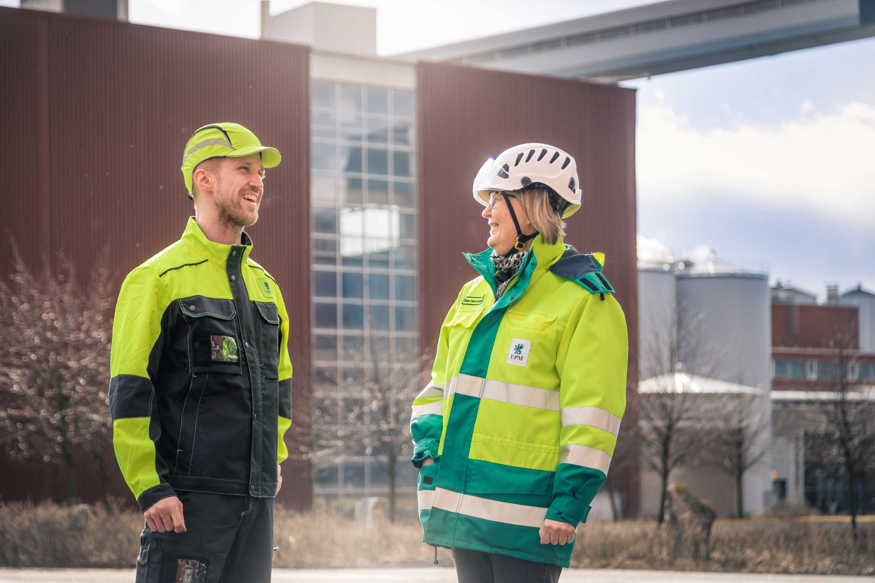 Two people outside UPM Rauma paper mill